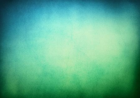 青のグラデーションに緑でグランジ テクスチャ背景。イメージは重要なペーパー穀物やテクスチャ 100 % で表示したときに表示されます。 写真素材