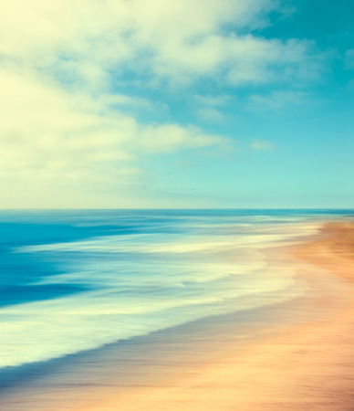 A blurred seascape abstract made with panning motion and long exposure.  Image displays soft, pastel colors in a retro style.