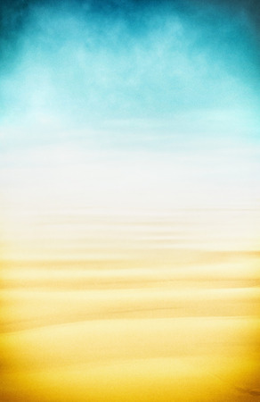A high-key seascape of sand, fog and sky.  Image displays a pleasing paper grain and texture at 100 percent.