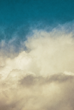 pleasing: Billowing storm clouds with a vintage, old-world look.  Image has a distinct and pleasing background texture visible at 100 percent.