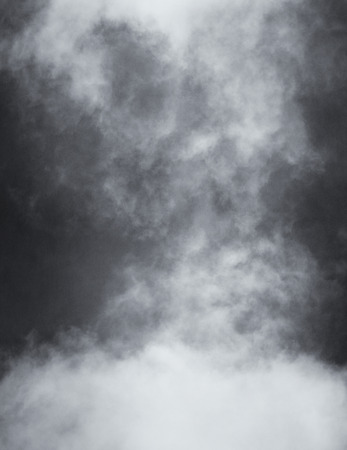 rendition: A black and white rendition of fog and clouds on a textured paper background.  Image displays a distinct paper grain and texture at 100 percent. Stock Photo