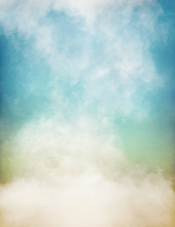An abstraction of fog and clouds on a textured paper background with a pastel color gradient.  Image displays significant paper grain and texture at 100 percent.