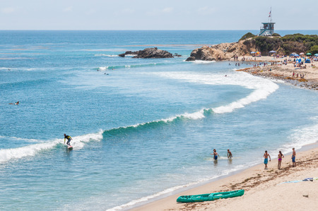 surfers: LEO CARRILLO STATE PARK, MALIBU, CALIFORNIA - JULY 22, 2015 - Surfers, swimmers and sunbathers enjoying a summer day in southern California.