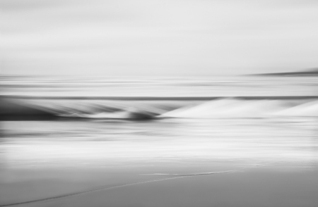 defocus: An abstract seascape in black and white made with a long exposure and panning motion. Stock Photo