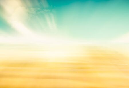 A complete abstraction of sand and sky.  Image features a yellow to green color gradient. Banco de Imagens
