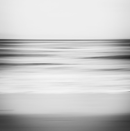 A black and white, abstract ocean seascape with blurred panning motion.