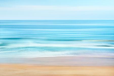 A tranquil seascape of the Pacific ocean off the coast of California.  Image features blurred water movement captured with a long exposure.