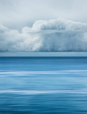 squall: WInter storm clouds hover over the Pacific ocean near Santa Barbara, California. Stock Photo