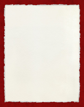 deckle: Watercolor paper with true deckled edges on a textured red background.  File includes a clipping path.