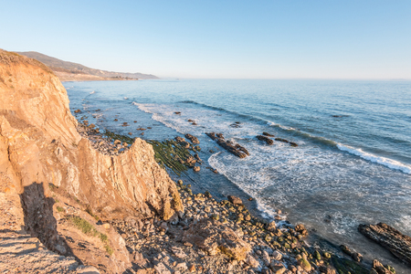 coastlines: A rocky cliff view of the Pacific ocean at low tide in Carpinteria, California. Stock Photo