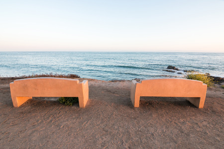ocean state: Two public benches overlooking the Pacific ocean at Carpinteria State Park, California. Stock Photo