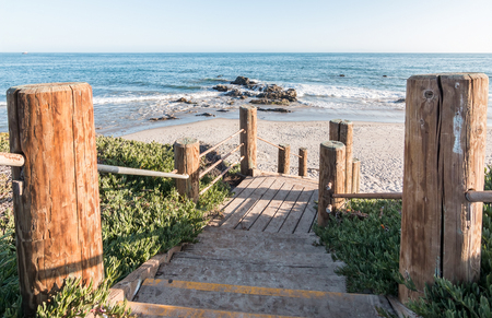 ocean state: Stairs leading down to the beach and Pacific ocean at Carpinteria State Beach, California.