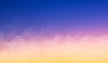 A fog cloudbank at sunset featuring a colorful gradient.  Made with a slightly long exposure for a soft focus effect.