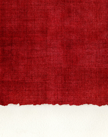 crosshatching: A section of deckled edge paper on a textured, red cloth background.