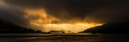 rheintal: spectacular sunset at river rhine wizh boats, rain, clouds, mountains