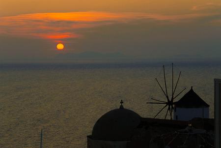 typical Santorini sundown wirh a mill