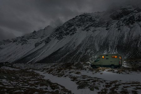 mobile home in winter weather in the moutains by night