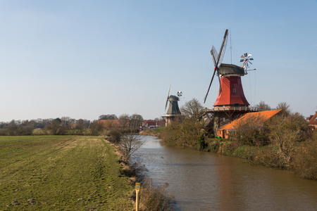 Traditional Dutch  Greetsiel twin mill Stock Photo