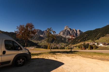 Oct. 2018, Alta Batia, Hochabteital, Dolomiten, Suedtirol, Italien, RV park in autumn on a pass road with blue sky
