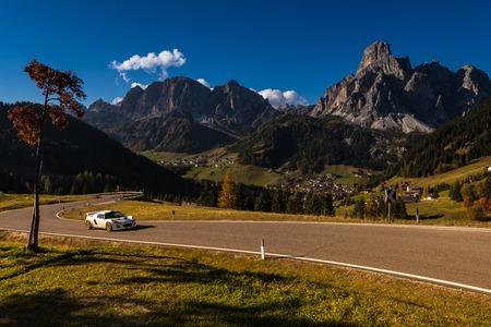 Oct. 2018, Alta Batia, Hochabteital, Dolomiten, Südtirol, Italien, Sports car in autumn on a pass road with blue sky