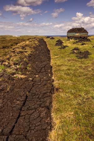 freshly cut fields of peat or turf from Scottish raised bog, peat removal, Durness, Scottish Highlands, Scotland, United Kingdom Stock Photo