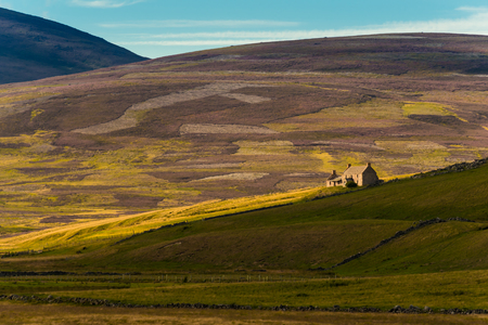typical, rual landscape with ancient ruins and endless pastures and pastures, Sutherland, Highlands, Scotland