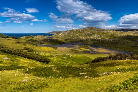 typical coastal landscape with endless pastures, Sutherland, Highlands, Scotland