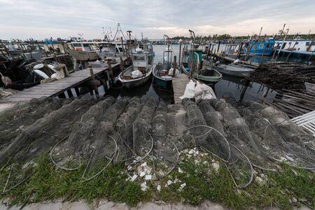 romantic fishing boats in the fishing port of Porto di Gorino, Delta del Po, Po Delta, Ferrara province, Emilia Romagna, Italy