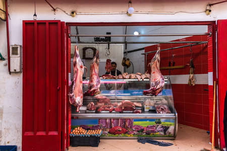 Alisha, Morocco - jan. 2020:ocal Butcher in an open air Moroccan market in Alisha