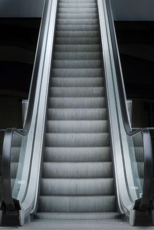 Escalator outside of the office building going up. Stock Photo