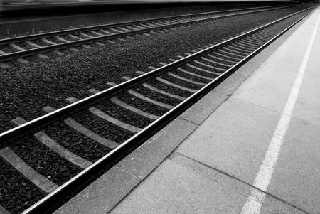 wood railroads: Railway lines at a train station disappearing into the distance. Stock Photo