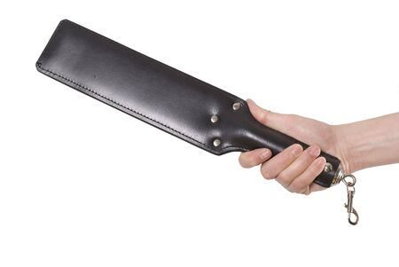 domination: Strict Leather Black Paddle in mans hand isolated over white background.  Stock Photo