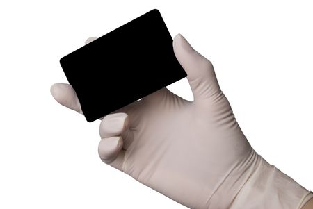 Hand in latex medical glove holding a credit card isolated over white background.