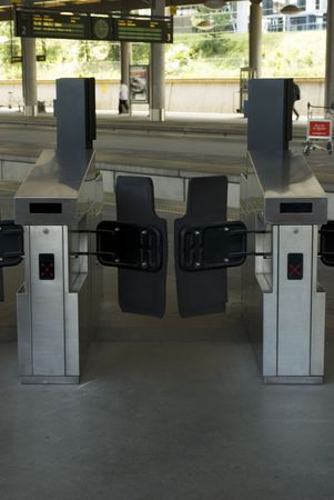tourniquet: Modern turnstile (Tourniquet ) on a railway station. Stock Photo