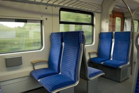 Interior of a train wagon with empty seats Stock Photo