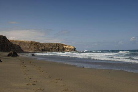 Human footprints on the beach Lapared on Canary Island. Fuerteventura, Spain Stock Photo