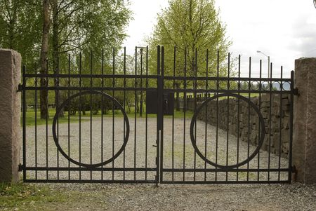 mesh fence: The old black wrought iron cemetery gate. Stock Photo