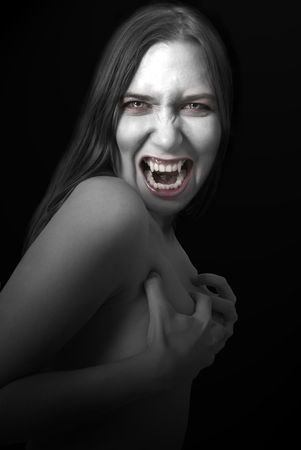 Portrait of a female vampire on black background. Stock Photo - 7140170