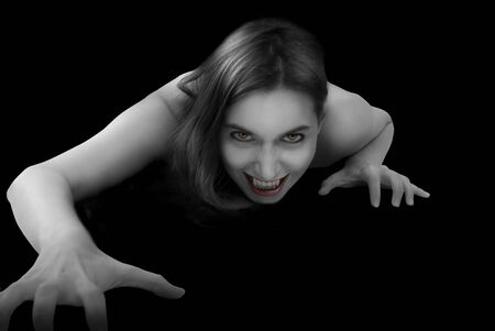 terrific: Portrait of a female vampire on black background.