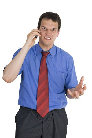 Angry young businessman talking on mobile phone isolated on white background. Stock Photo - 7312680