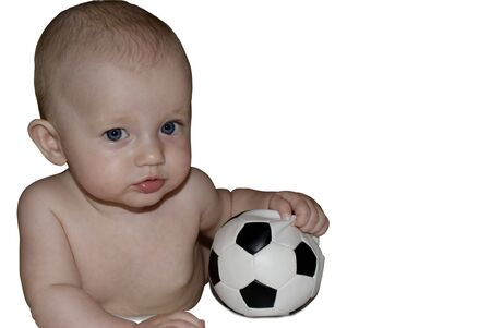 Baby playing with a soccer ball. Isolated over white background.