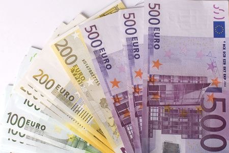 Close-up of the fan of 5, 10, 20, 50, 100, 200 and 500 Euro banknotes on white background