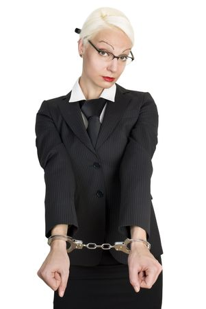 Young beautiful business woman with handcuffs on her hands. Isolated over white background. photo