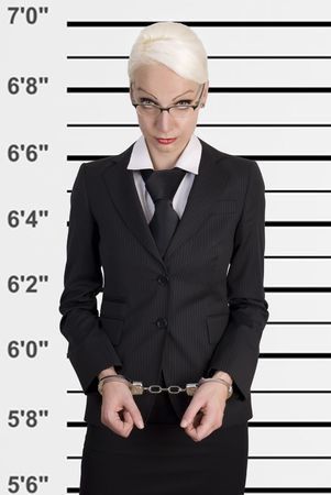 female prisoner: Mug shot of young business woman locked in handcuffs.