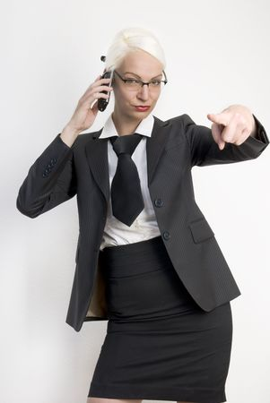 Young beautiful business woman with a phone in her hands. photo