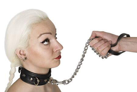 Sexy Blond woman with leather collar and leash holding by males hand.
