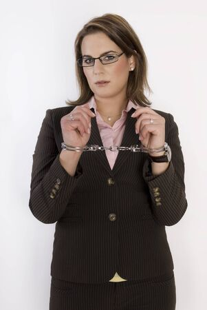 handcuffs woman: Young beautiful business woman with handcuffs on her hands. Not Isolated. Stock Photo