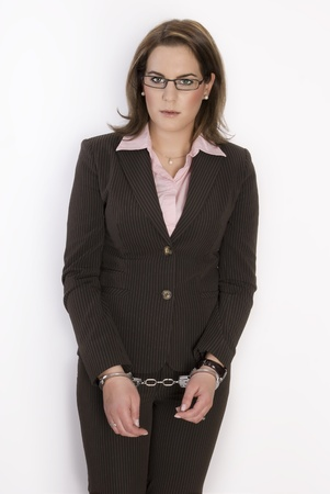 Young beautiful business woman with handcuffs on her hands. Not Isolated. Stock Photo - 8510192
