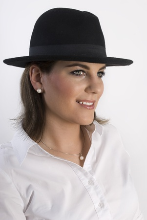 Portrait of young attractive elegant woman in black hat. Not isolated. Stock Photo