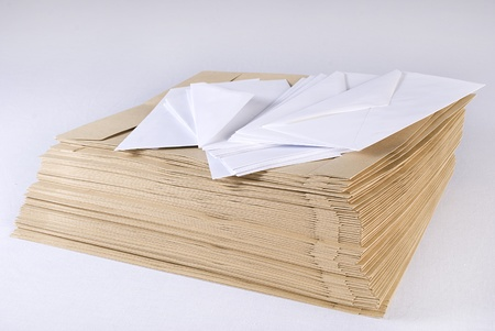 Pile of envelopes over white background. Not isolated.